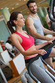 stock photo of cardio  - Couple doing cardio training program in fitness center - JPG