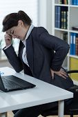 picture of lumbar spine  - Woman with sedentary lifestyle having pain in lumbar spine - JPG