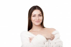 pic of strip tease  - Portrait of smiling sexy young woman taking off white bathrobe undress exposing shoulders with provocative look isolated on white background - JPG
