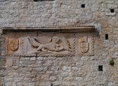 stock photo of southern  - On the southern facade of the Revelin tower in Korcula in Croatia there is a relief or plaque of the winged lion of Venice or the lion of Saint Mark - JPG