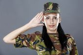 picture of army soldier  - Woman army soldier saluting isolated on gray background - JPG