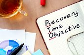 stock photo of objectives  - Notepad with word RTO recovery time objective concept and marker - JPG