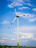 stock photo of generator  - wind generator turbine on a sunny day - JPG
