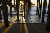 stock photo of outer  - View of fishing pier from underneath at sunrise  - JPG