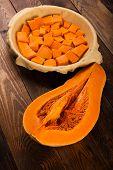 pic of pumpkin pie  - Raw pumpkin pie on the brown wooden background  - JPG
