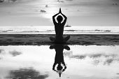 picture of yoga silhouette  - Silhouette of yoga woman on sea coast - JPG