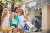 stock photo of overspending  - Three young girls - JPG