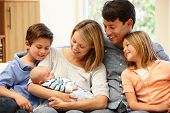image of new years baby  - Family at home with new baby - JPG