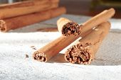 foto of cinnamon sticks  - Some cinnamon sticks tied with a natural rope - JPG