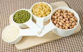 picture of carbohydrate  - Foods High in Carbohydrate Raw Pasta Rice Peanuts and Mung Beans in Plastic Measuring Cups - JPG