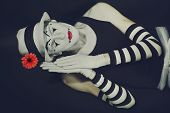image of mime  - sleep mime in white hat with red flower on a black background - JPG