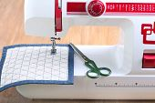 image of sewing  - Sewing machine and sewing accessories on wooden table - JPG