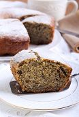foto of icing  - Poppy seed and raisin ring cake with icing sugar on top - JPG
