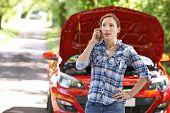 picture of breakdown  - Female Motorist Phoning For Help After Breakdown - JPG