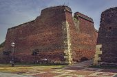 picture of fortified wall  - Ruins of brick fortification walls and cobblestone alleys of the medieval strategic fortress of Alba Iulia Romania - JPG