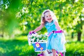 stock photo of little kids  - Happy child riding a bike - JPG