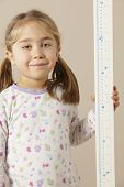 stock photo of measuring height  - 5 year old girl measuring height - JPG