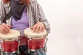 pic of bongo  - Funny elderly lady makes music with a wooden bongo - JPG
