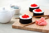 stock photo of chopsticks  - Sushi rolls with ginger - JPG