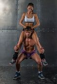 image of squatting  - Athlete muscular sportsman doing exercising squats with woman sitting on his shoulders Crossfit fitness sport training lifestyle bodybuilding concept - JPG