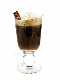 stock photo of irish  - Irish Coffee is made of coffee irish whiskey and light cream garnished with cinnamon sticks - JPG