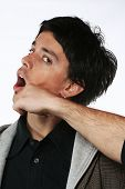 stock photo of spank  - man punch in face with fist - JPG