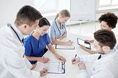 Постер, плакат: medical education health care people and medicine concept group of happy doctors or interns with