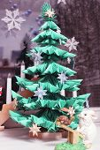 stock photo of the hare tortoise  - Module origami christmas tree with stone hare  - JPG