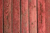 stock photo of red barn  - weathered and peeling red painted barnwood texture - JPG