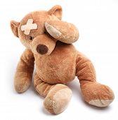 stock photo of teddy-bear  - Ill teddy bear with plaster on its head - JPG