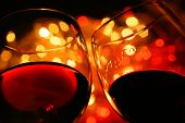 stock photo of red wine  - two wine glasses wirh red wine over backlighted background - JPG
