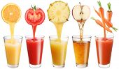 Conceptual image - fresh juice pours from fruits and vegetables in a glass. Photo on a white backgro
