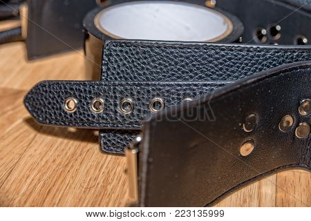 poster of The Leather collar with rivets for bondage
