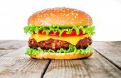 Tasty and appetizing hamburger cheeseburger poster