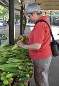 Woman At Farmers' Market - Corm