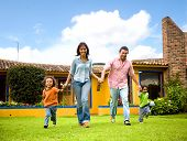 stock photo of happy kids  - happy family running and having fun outdoors smiling and enjoying - JPG