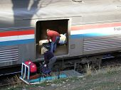 stock photo of amtrak  - loading baggage on Amtrak at Glenwood Springs - JPG