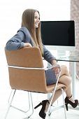 woman administrator sitting at the workplace poster