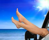 Beaitiful female legs against the sea and summer blue sky. Vacation, travel summer holidays concept. poster