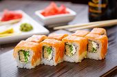 Beautifully Decorated Sushi On A Wooden Board. Sushi Is The Traditional Asian Food. Roll Of Sushi Pr poster