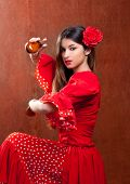 foto of castanets  - Castanets gypsy flamenco dancer Spain girl with red rose - JPG