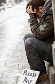 foto of begging  - Homeless Young Man Begging In Street - JPG