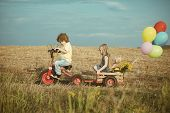 Active Toddler Kid Playing And Cycling Outdoors. Children Farmer In The Farm With Countryside Backgr poster