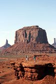 People Standing In The Distance In Monument Valley poster