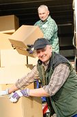 pic of movers  - Male mover loading van with cardboard box delivery service - JPG