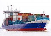 stock photo of container ship  - fully laden container cargo ship entering port - JPG