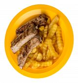 Grilled Pork Ribs With French Fries On A Yellow Plate. Pork Ribs With French Fries On A White Backgr poster