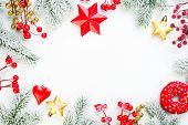 Christmas Background. Xmas Composition Border With Snowy Fir Branch, Red Holly Berries, Gold Stars A poster
