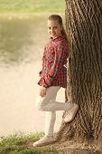 Feeling Relaxed. Adorable Girl With Long Blond Hair In Casual Plaid Style. Little Girl Wearing Fashi poster