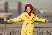 Stylish Child In Parisian Beret And Coat. Little Girl Outdoor. Spring Weather. Autumn Trend. Happy L poster